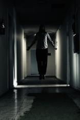 Man Levitating in Dark Hallway,