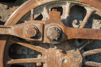 detail of driving rod mechanism on old steam locomotive