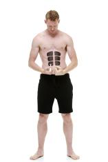 Shirtless man drawing a fake six pack