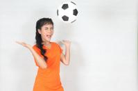Half Portrait Beautiful woman throw up ball  with wearing footba