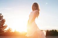 Young woman under sunset light, outdoors portrait. Soft light an