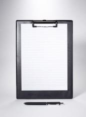 Folder and a pen with blank paper on white background