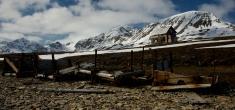 Rickety hut behind rusty old mining equipment