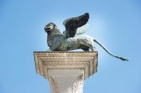 Winged St Mark Lion Venice symbol on its column. Italy