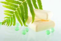 The soap bars on  greenish background