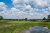 Golf course against deep blue sky
