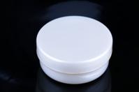 Box of cream on black background