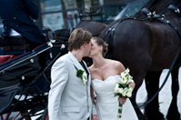 Wedding couple in front of coach
