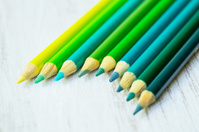 Blue and Green Colored Pencils in a Row