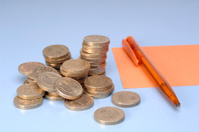 Pencil and coins money