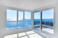 empty room with windows to sea