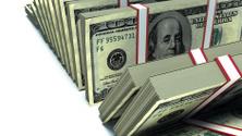 Row of packs of dollars. Lots of cash money