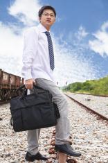 Businessman waiting train