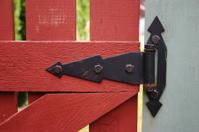 Black gate hinge on picket fence