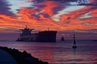 Bulk Carrier Entering Harbour at Sunrise