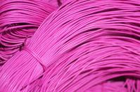 Shoe laces or cords. Pink color