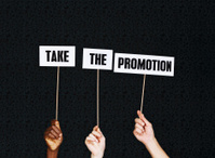 """""""Take the promotion"""" say hand-held signs. Of course!"""