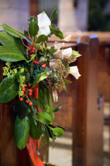 Church pew with wreath at Christmas