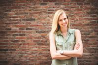 Dutch woman portrait against a brick wall