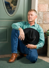 Cowboy Resting on a Porch