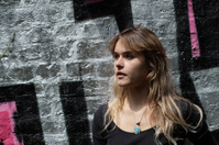 London outdoor girl and silver graffiti wall