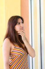 Hispanic Woman Windowshops Vertical