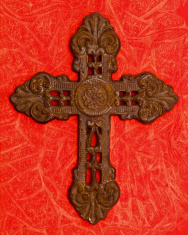 Religious: Rusted Iron Cross on Red Background