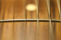 Guitar fret and metal strings