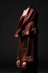 Mystery monk praying on kneels
