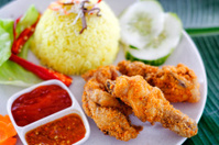 Fried chicken served with turmeric rice