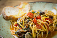 Homemade pasta with seafood and cherry tomatoes