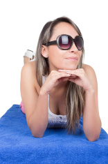 beautiful young girl sunbathing on a towel