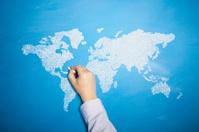 Hand drawn world map on a blue chalkboard