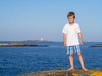 Boy at sea coast