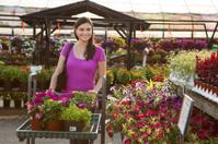 Woman Shopping for Plants at Outdoor Garden Center.