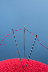 3 needles, 1 red thread