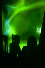 Silhouettes of two girl in disco