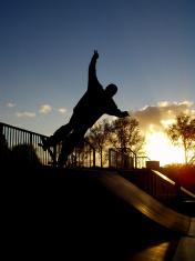 Skater on ramp in sunset