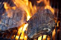 rib eye steak flames