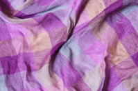 Textile fabric in yellow - purple and blue plaid