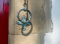 vintage door bell on ancient home in wales, uk