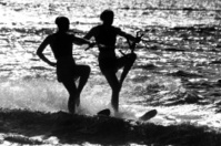 Silhouette of two female skiers.