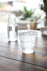 Water in glass in wood background