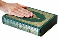 Hand on the Holy Koran Book