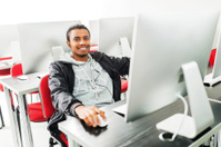 African American man in a computer lab.