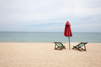 Beach Chairs and an umbrella on an empty beach