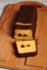 Chocolate glazed loaf cake with strawberry jam