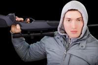 guy with scoped gun