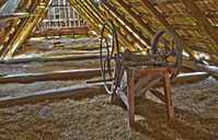 old chaff machine on the billet of village house