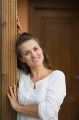 happy woman standing on doorstep
